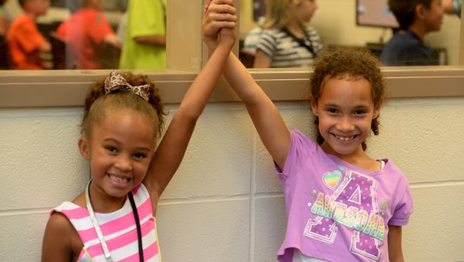 Arayria Bragg and Aviana Wilson, right, at the Boys and Girls Club of Wayne County Friday, Aug. 7, 2015, at the Richard E. Jeffers Unit in Richmond.