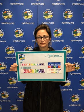 Oksana Zaharov, a 46-year-old mother of two from Edgewater, won a $ 5 million prize on a lottery ticket she bought on a whim while shopping in Manhattan.