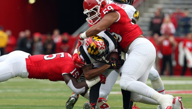 Darnell Davis (59), shown here last season against Maryland, is settling in to an increased role at defensive end for Rutgers