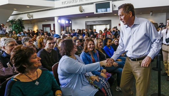 John Kasich greets supporters after speaking at a campaign