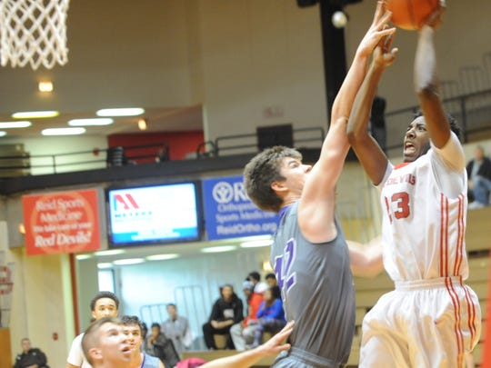 Adrion Gibson of Richmond, right, goes for a shot against