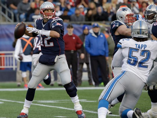 New England Patriots quarterback Tom Brady (12) throws a pass in the second half of an NFL football game against the Detroit Lions Sunday, Nov. 23, 2014, in Foxborough, Mass. (AP Photo/Stephan Savoia)