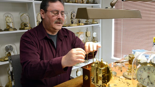 Chris Nimon repairs a clock in this 2016 photo. Nimon, the owner of Horolovar, a company that makes parts for and repairs anniversary clocks, died Saturday.