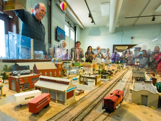 My Brother's Place owner John Gutierrez, left, reveals the minature version of the iconic Las Cruces restaurant, on Saturday, October 22, 2016, as the newest addition to the model railroad display at the Las Cruces Railroad Museum.