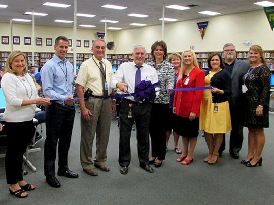 The Smyrna High School library held a ribbon-cutting event for the renovations to the library Monday, Sept. 21, 2015.