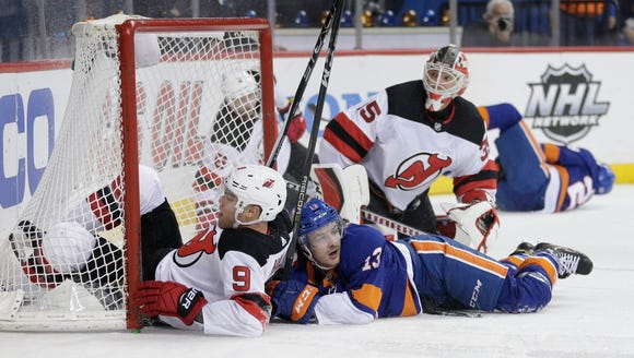 New Jersey Devils' Taylor Hall, left, and New York