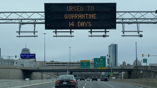 A highway sign in March urged people arriving in Massachusetts to quarantine for 14 days.