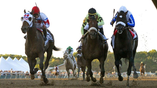 In this image provided by EQUI-PHOTO, Morning Line, right, with John Velazquez riding, edges out First Dude and jockey Robby Albarado to win the 2010 Pennsylvania Derby at Parx Racing.