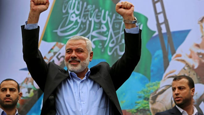 In this Dec. 12, 2014, file photo, Hamas leader Ismail Haniyeh greets supporters during a rally to commemorate the 27th anniversary of the Hamas militant group in Jebaliya in the northern Gaza Strip.