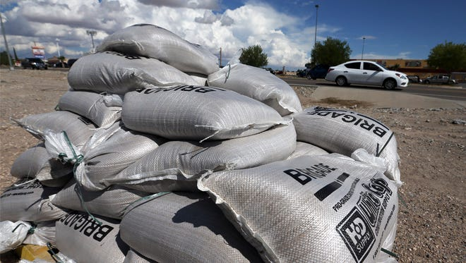 Sandbags are shown on a pallet Friday outside the Road & Bridge Fabens Warehouse at 1331 N. Fabens St. in Fabens. The warehouse has sandbags available for residents due to recent rains.