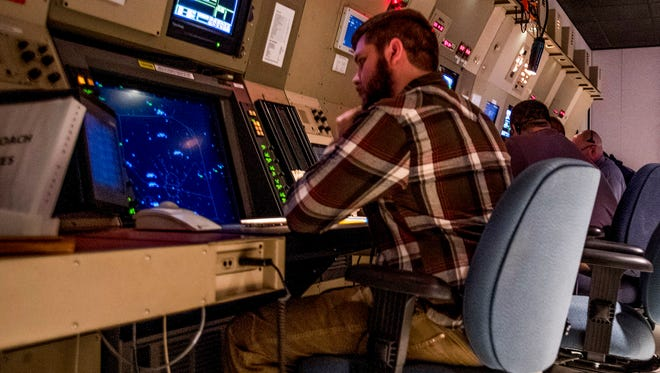 Air traffic controller John Leslie sits at his Terminal Radar Approach Control station in Montgomery, Ala. on Tuesday October 24, 2017. Leslie guided a PSA Airlines flight to a safe emergency landing in Selma on June 21, 2017.