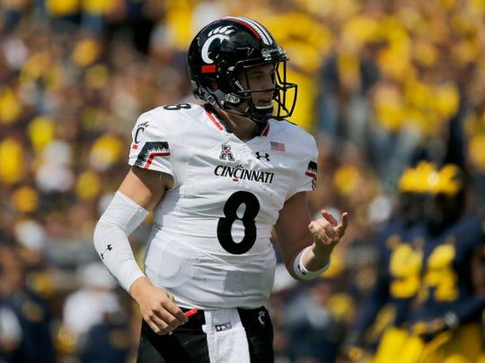 Cincinnati Bearcats quarterback Hayden Moore (8) runs