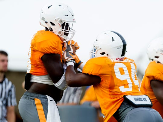 Tennessee's linebacker Ja'Quain Blakely (48)  and Tennessee's defensive lineman TJ Minnifee (94)  during Tennessee fall football practice at Anderson Training Facility in Knoxville, Tennessee on Tuesday, August 1, 2017.