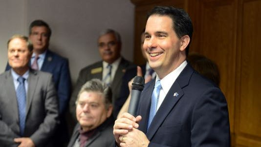 Wisconsin Gov. Scott Walker, right, has said he would call the state legislature into special session if courts ruled against the state's voter identification law.