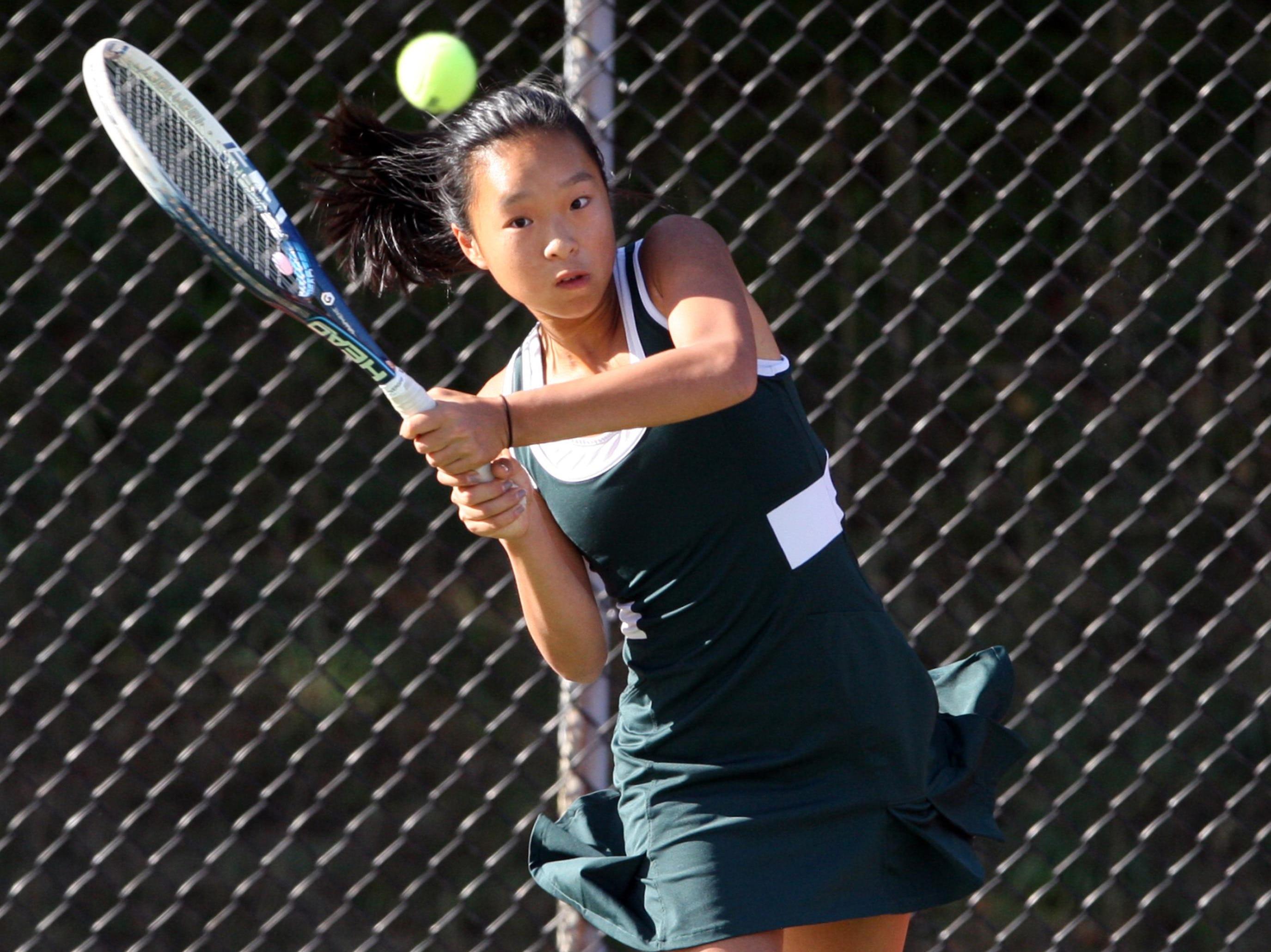 East Brunswick's Jennifer Chen returns a volley during the GMC Tournament first singles final on Sept. 23, 2014.
