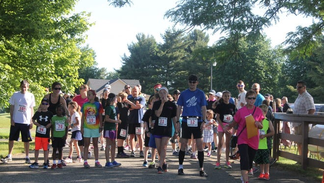 """A group of runners and walkers raise money for the Genetic Disease Foundation in honor of Brighton area resident Dale Love's granddaughter, Mia Jeanette Walts, who passed away from an incurable disease in 2011, in this photograph taken June 4, 2016. This year's """"Miles for Mia"""" benefit will be held Saturday, June 3, starting from Burrough's Roadhouse in Genoa Township."""