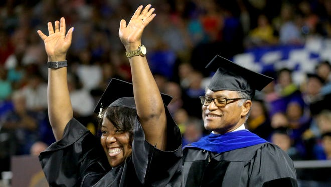 Kimberly Osborne, celebrates receiving her Doctor of Education as she after being hooded by Donald Snead, on Saturday, Aug. 6, 2016, during MTSU's graduation.