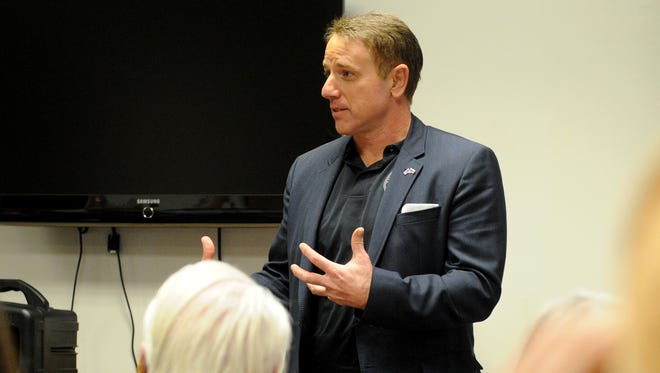 Texas Senate District 30 candidate and State Rep. Pat Fallon gives a speech at a Tea Party Meeting Thursday, Dec. 7, 2017, at Red River Harley Davidson.