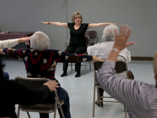 Patricia Tavis, Howell, gives a chair yoga class at the Howell senior center.