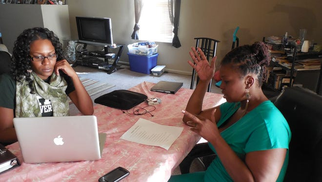 Markeisha Wilson, right, meeting with her family intervention specialist Monae Davis.