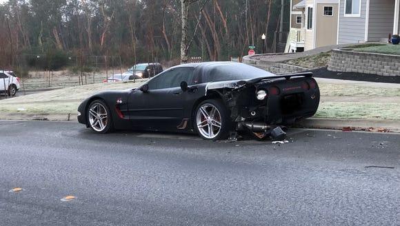 A damaged Corvette parked on Schley Boulevard.