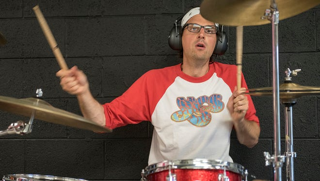 Nick Brandon is director of communications for the Plymouth-Canton Community Schools district by day and a rock and roll drummer by night.