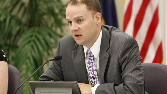 State Education official Kevin Brown opens up a public hearing on the new science standards in public schools at the Capital Plaza Tower in Frankfort, Kentucky. July 23, 2013