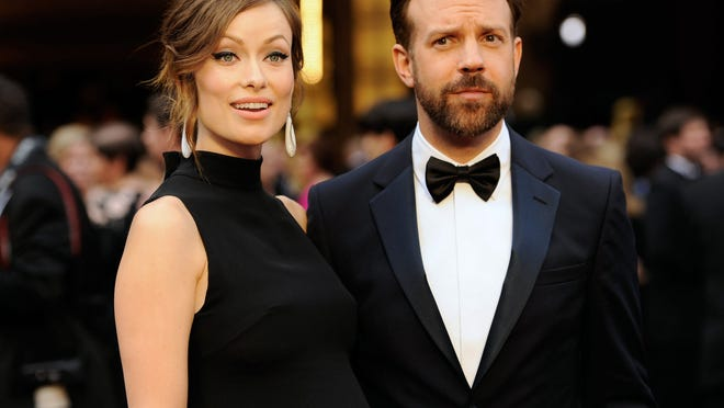 Olivia Wilde, and Jason Sudeikis arrive at the Oscars at the Dolby Theatre in Los Angeles