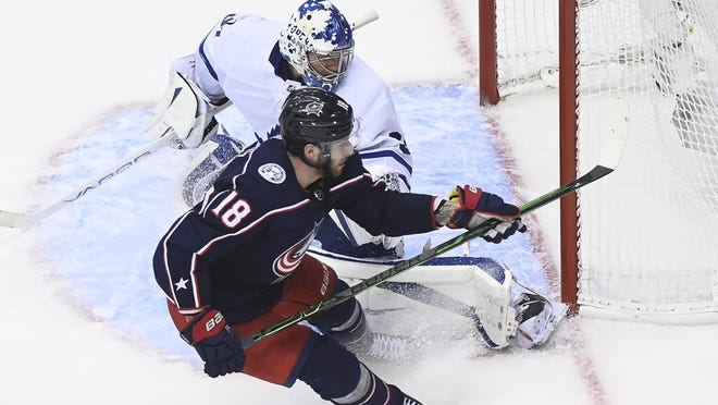 Columbus Blue Jackets center Pierre-Luc Dubois (18) scores the winning goal past Toronto Maple Leafs goaltender Frederik Andersen (31) during overtime on Thursday.