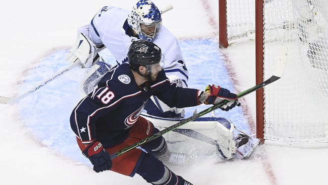 Blue Jackets center Pierre-Luc Dubois scores the winning goal past Maple Leafs goaltender Frederik Andersen on Thursday.