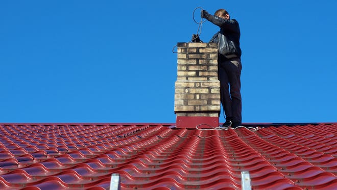 If you have a gas or wood-burning fireplace and plan on using it, you should hire a professional chimney sweep.