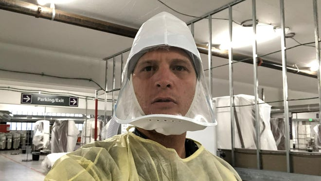 Dr. Jacob Keeperman's Nov. 12 selfie has been used to fuel false claims that the pandemic is a hoax. The Renown Transfer and Operations Center medical director snapped the photo on the opening day of the Renown Regional Medical Center's alternative care site in a parking garage.