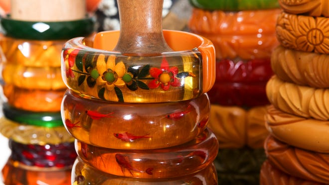 Bakelite, a plastic used to make telephone and radio casings as well as jewelry has taken on collectible status.