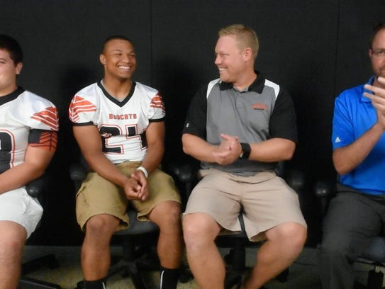 From the left, Northeastern Bobcats John Wadkins, Chris