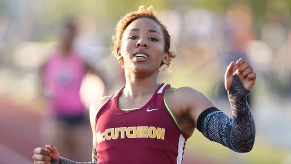 McCutcheon's Alanah Owens wins the 200 meter dash with