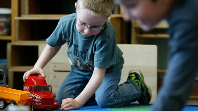 Milo Fosberry plays with a toy truck during kindergarten class at Jefferson Road Elementary School.