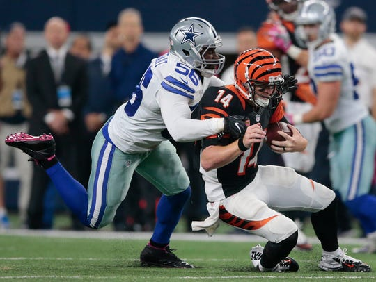 Bengals quarterback Andy Dalton is tackled by Cowboys