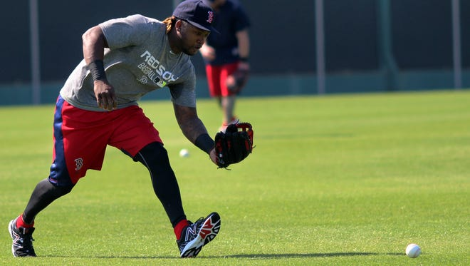 Hanley Ramirez runs through outfielding drills Friday morning during the Boston Red Sox's unofficial workout at Jet Blue Park in Fort Myers, Florida.