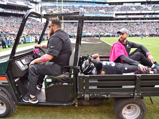 Eagles cornerback Ron Brooks is carted off the field after tearing his quad in October.