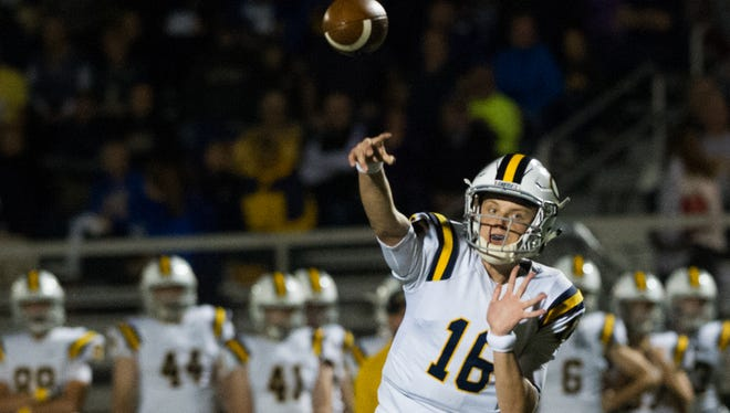 Castle's quarter back Dayne Keller (16) passes the ball in the first quarter of game against North at Bundrant Stadium in Evansville, Ind. Friday evening, Oct. 7, 2016.