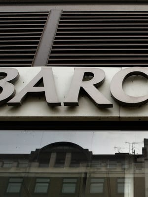 File photo shows a company sign at a Barclays bank branch in London in January 2009.