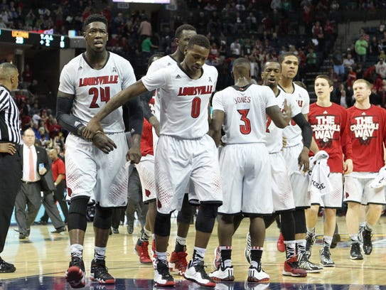 Louisville players Montrezl Harrell (24) and guard