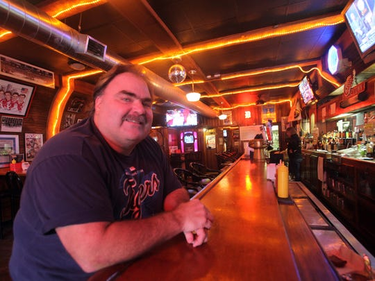 Tommy Burelle of Ferndale is the owner of Tommy's Detroit Bar & Grill located  at 624 3rd St. in downtown Detroit leaning on his bar Friday, Oct. 5, 2012.