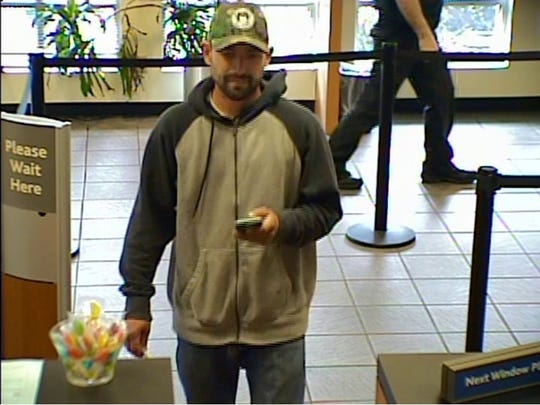 Smyrna Police are searching ofr the identity of this man, who may have been involved in an armed bank robbery at a Smyrna SunTrust location Monday afternoon.