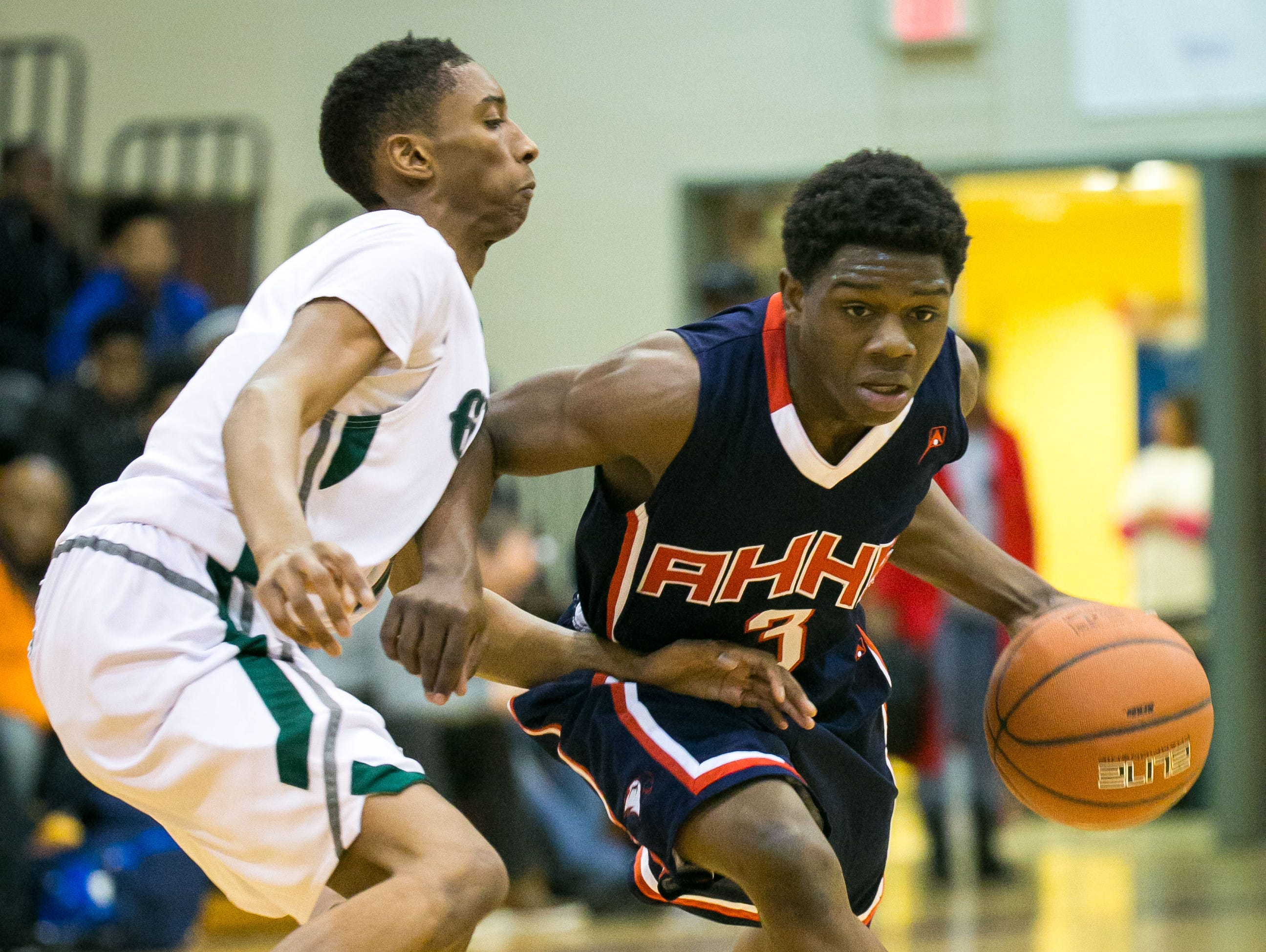 Papie Roberts of American History dribbles around Keon Taylor of Mount Pleasant.