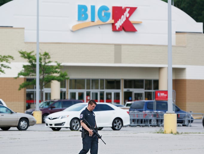 Police check cars in the parking lot following a bomb threat Monday, June 23, 2014, at the Kmart off Ind. 38 East in Lafayette. After a little over an hour, police determined that no bomb had been found.