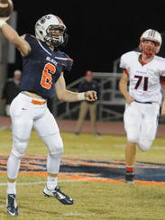 Blackman QB Connor Mitchell fires a pass during Friday's