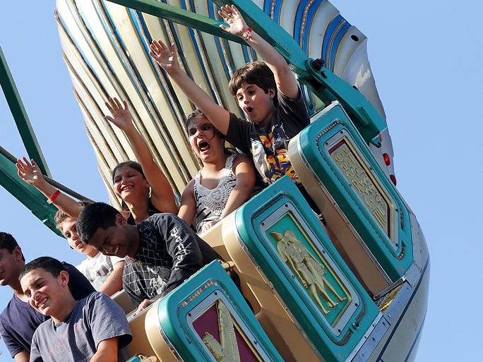 "Fair-goers take a ride on ""Pharaohs Fury"" during the third night of the annual Middlesex County Fair, Wednesday, August 6, 2014, in East Brunswick, NJ. Photo by Jason Towlen"