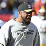 Pittsburgh Steelers head coach Mike Tomlin reacts during warm ups prior to the AFC Divisional round playoff game against the Denver Broncos at Sports Authority Field at Mile High.