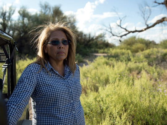 Becky Garibay stands at the site where her brother
